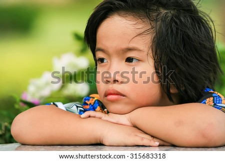 child one with thinking. Closeup headshot ( soft focus on the eyes ) - stock photo