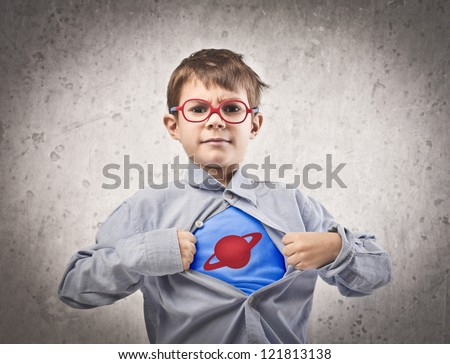 Child opening his shirt like a superhero - stock photo