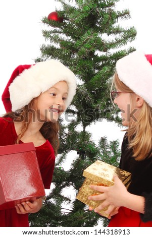 Child opens presents during winter holidays