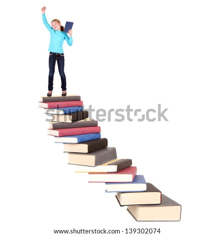 Child or girl on top of staircase of books cheering, isolated on white