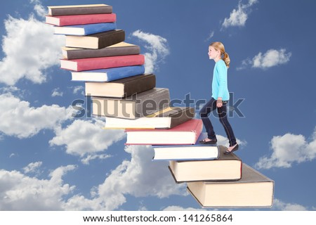 Child or young teen climbing a stair case of books with a cloudy background