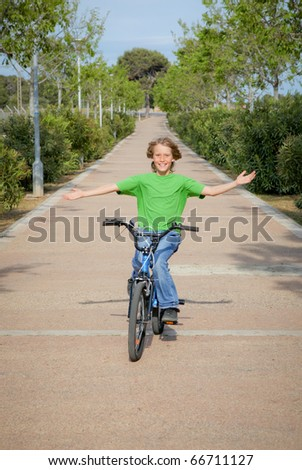 child out playing riding bike or bicycle