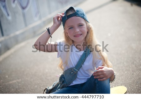 child outdoors in the life style in graffiti wall - stock photo