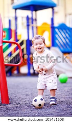 Child outdoors on playground - stock photo