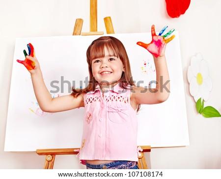 Child paint picture in preschool. Child care. - stock photo