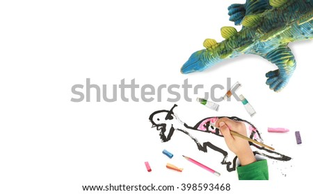 Child Painting dinosaur  with bright watercolor, copyspace for text. - stock photo