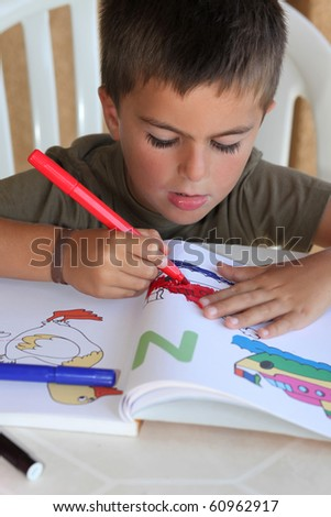 child painting with felt-tip - stock photo
