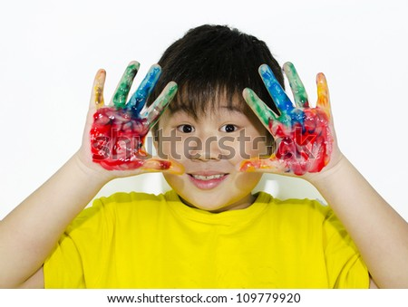 child painting with his hands
