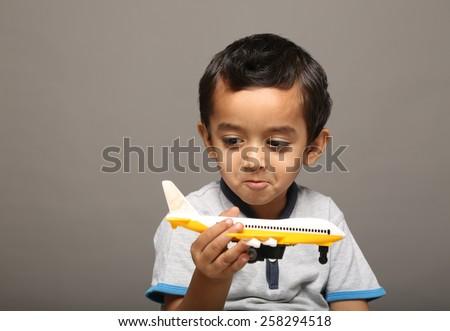 Child palying with an aeroplane - stock photo