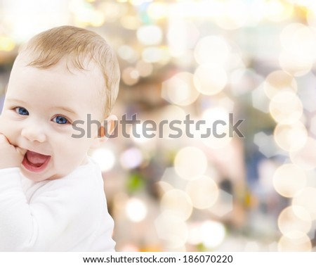 child, people and happiness concept - adorable baby boy - stock photo