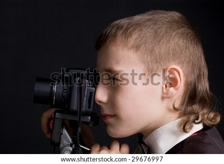 child photographer on a black background