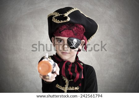 child pirate costume and background - stock photo