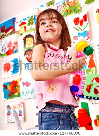 Child play block in play room. Preschool. - stock photo