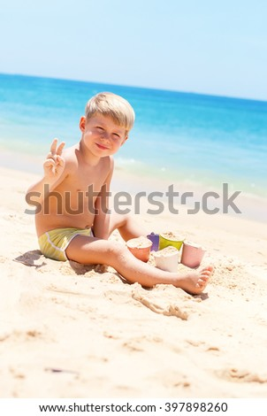 Child Play Colorful Buckets on Sand Beach Blue Sea Outdoor
