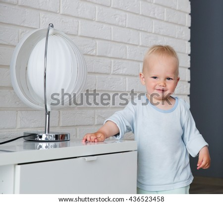 Child playing and discovery at a home interior