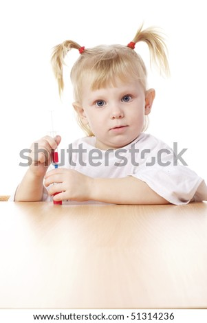 child playing as a doctor with syringe