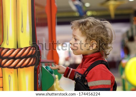 Child playing at game amusement park