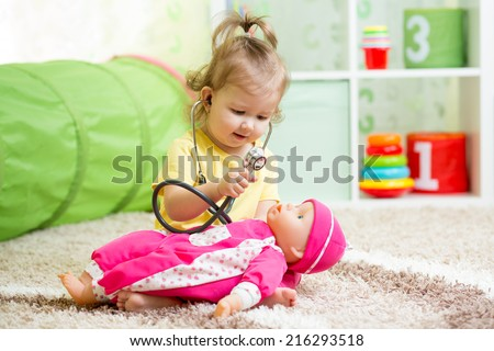 child playing doctor with toy - stock photo