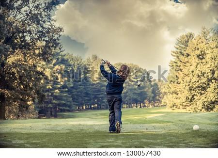 child playing golf - stock photo