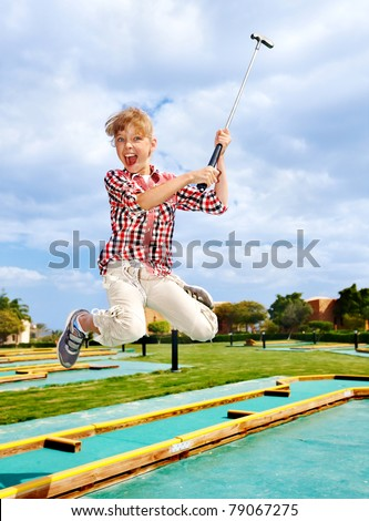 Child playing golf in park. Outdoor. - stock photo