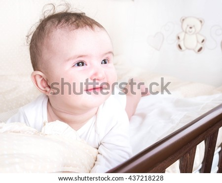 Child playing in a bed and does not want to sleep