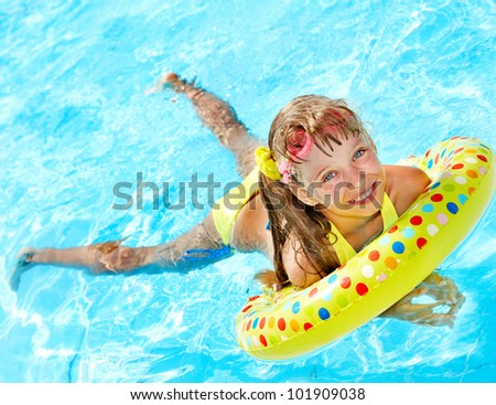 Child playing in swimming pool. Summer outdoor. - stock photo