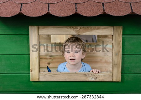 Child playing in tree house - stock photo