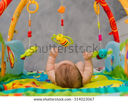 child playing lying in Mobile