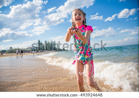 Child playing on a Queensland beach