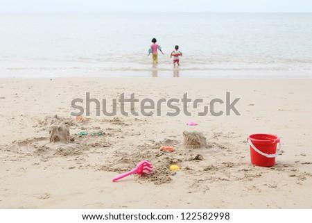 Child playing on beach - stock photo