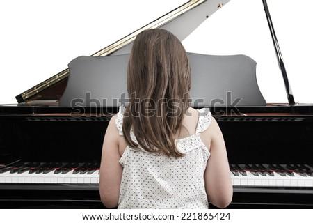 Child Playing Piano - stock photo