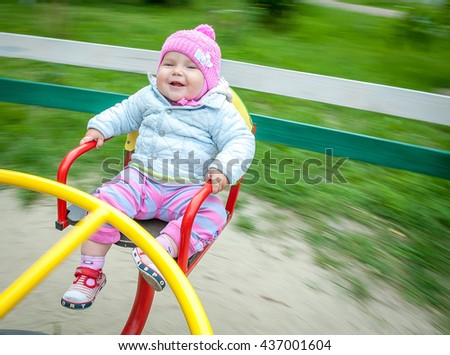 Child, Playing, Playground, summer, childhood, leisure and people concept - happy little girl on children playground - stock photo