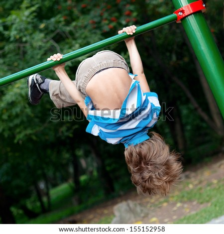 Child playing sports outdoors - stock photo