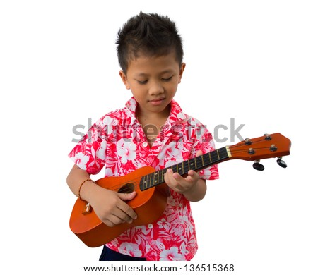 Child playing the guitar isolated Hawaii style