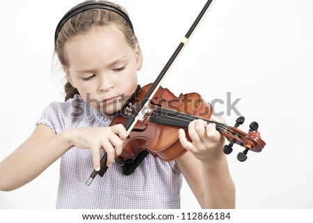 Child playing violin on isolated white background - stock photo