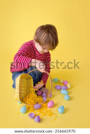 Child playing with an easter egg basket, easter egg hunt concept.