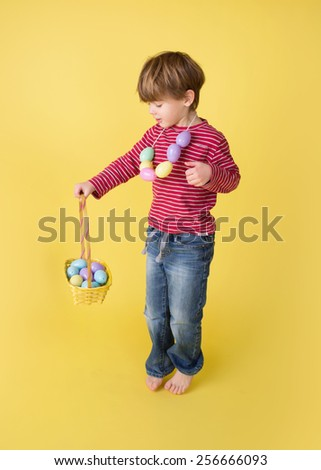 Child playing with an easter egg basket, egg hunt concept.