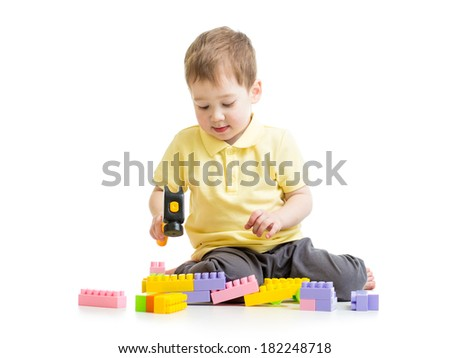 child playing with block toys - stock photo