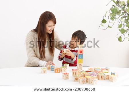 Child playing with blocks - stock photo