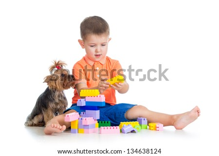 Child playing with building block toys