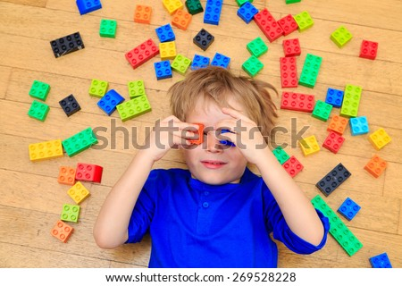 child playing with colorful plastic blocks indoor, early learning - stock photo