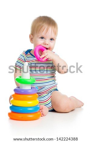 child playing with colorful toy isolated on white - stock photo