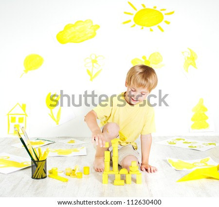 Child playing with construction blocks. Development and creativity concept.