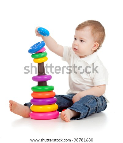Child playing with educational cup toys. Isolated on white background - stock photo