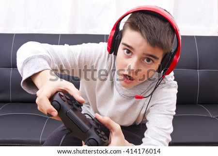 child playing with game console
