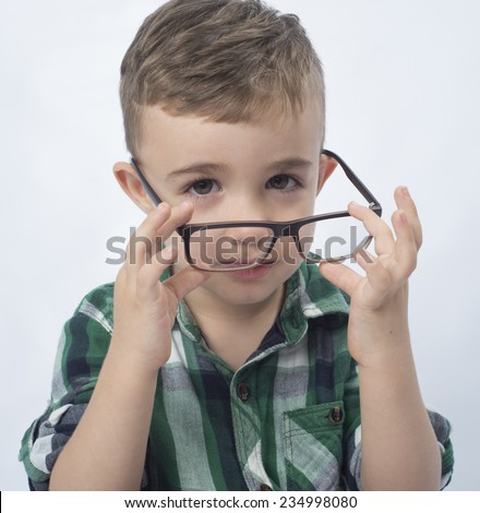 child playing with glasses