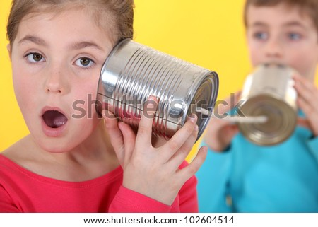 Child playing with jars of preserves - stock photo