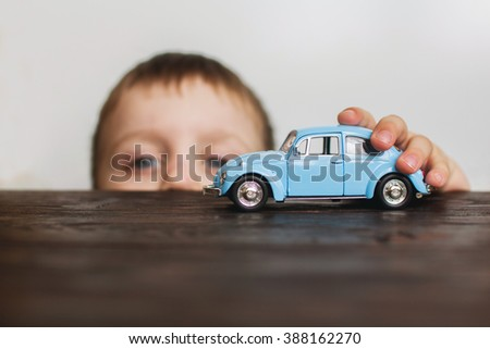 child playing with the car close  - stock photo