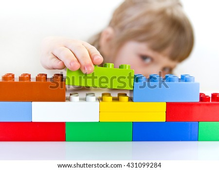 child playing with toy blocks - stock photo