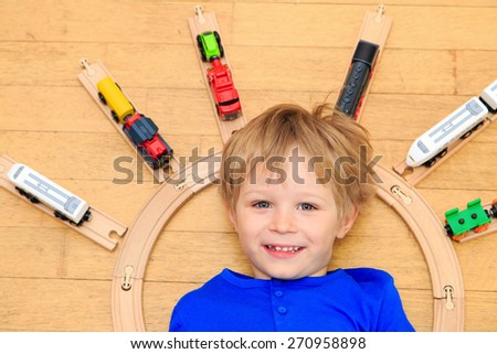 child playing with trains indoor, early learning - stock photo